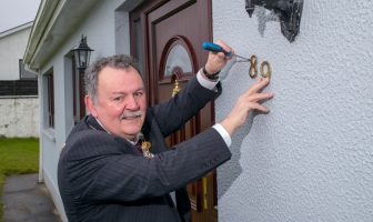 Mayor of Derry City and Strabane District Council, Councillor Maolíosa McHugh, launches the home numbering campaign at his home in Castlederg.