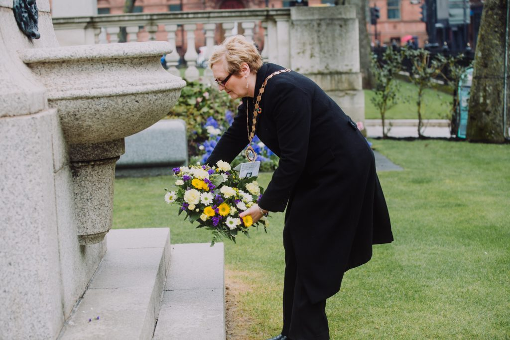 Deputy Lord Mayor, Councillor Sonia Copeland lays a wreath at the Titanic Memorial to remember more than 1,500 people who perished during the sinking of the RMS Titanic in 1912 during the Titanic Memorial Service in the grounds of Belfast City Hall.