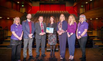 Mayor of Derry City and Strabane District Council, Councillor Maolíosa McHugh, presents Access Inclusion Officer at DCSDC Louise Boyce with the Quest Plus accreditation certificate for the Alley Theatre. Included in the image are staff Tina Molloy, John Kerr, Jacqueline Doherty, Emma Devine and Daphne Lynn.