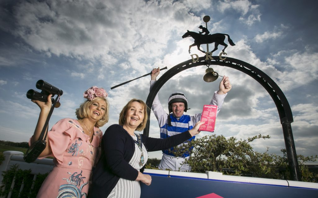 Cllr Roisin Mulgrew, Chairperson Newry Mourne & Down District Council gets a helping hand from Downpatrick lady Donna McLoughlin and Co. Wexford Jockey Sean Flannagan to launch DownTime, the first in an series of summer events and Giant adventures happening across the district of Newry Mourne & Down in the summer of 2018