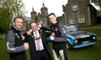 Rally drivers, John and Jonny Mulholland with Mayor of Antrim and Newtownabbey, Councillor Paul Hamill. The father and son pair are competing against each other in the rally which will start and finish in Antrim Castle Gardens on 17 & 18 August. Credit: Stephen Davison