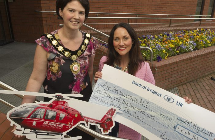 Chair of Mid Ulster District Council, Councillor Kim Ashton is pictured presenting a cheque for £1,644.50 to Karen Anderson from the Air Ambulance NI.