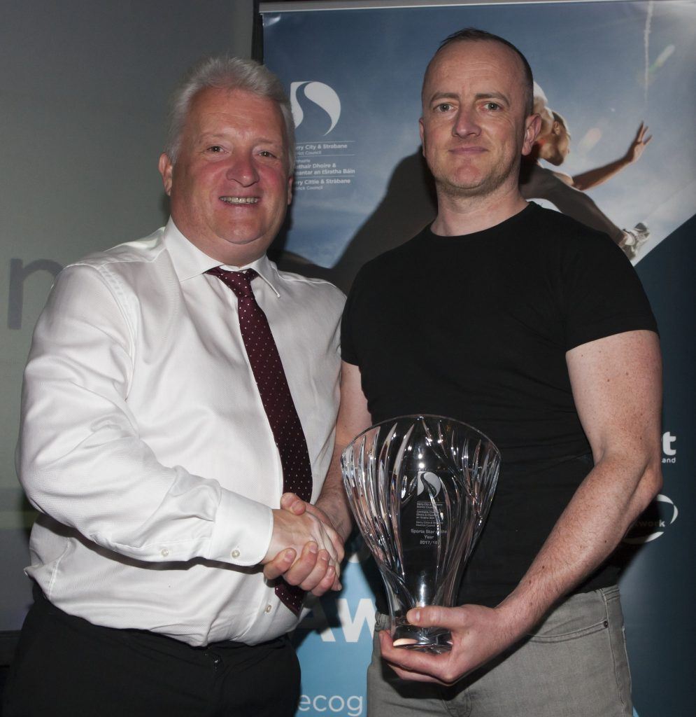 - Stephen Maguire presenting the Sports Star of the Year award to Trevor McGlynn, husband of recipient Ann Marie McGlynn, Strabane at the DCSDC Annual Sports Awards. Credit: Jim McCafferty Photography