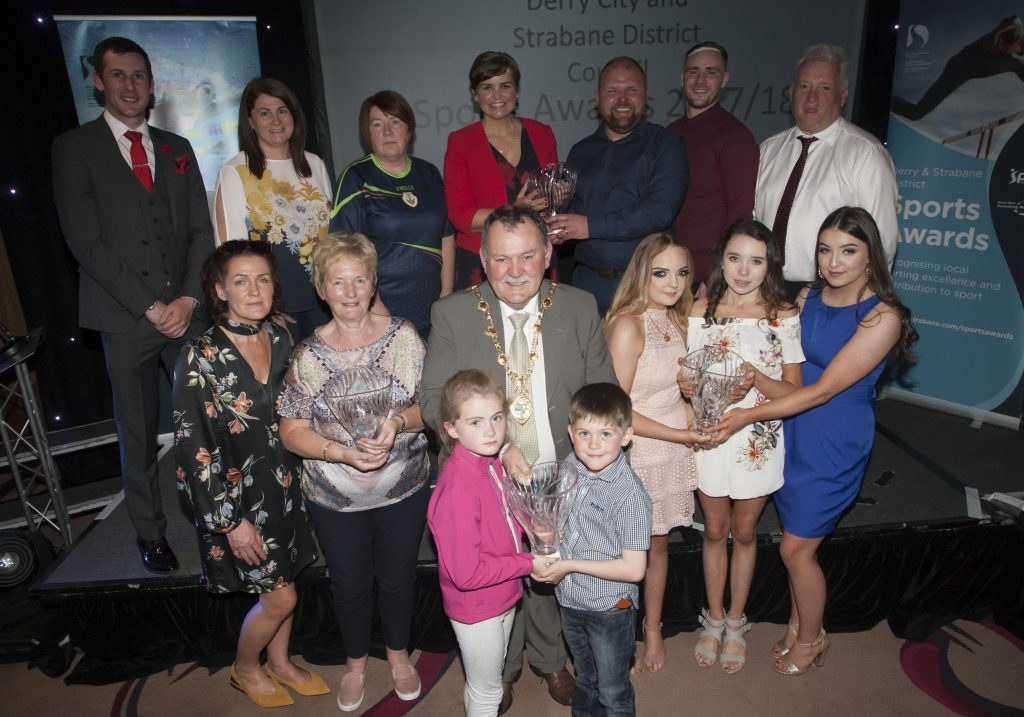 The Mayor of Derry City and Strabane District Council, Councillor Maoliosa McHugh pictured with group award winners at the DCSDC Annual Sports Awards held in the City Hotel on Wednesday night last. Included in photo are MC Denise Watson and special guests Dr. Michael McKillop and Stephen Maguire. Credit: - Stephen Maguire presenting the Sports Star of the Year award to Trevor McGlynn, husband of recipient Ann Marie McGlynn, Strabane at the DCSDC Annual Sports Awards. Credit: Jim McCafferty Photography