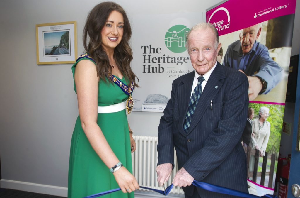 Mayor of Mid & East Antrim Council, UUP Cllr Lindsay Millar, pictured along with John McNeill cutting a ribbon to mark the official opening at The Heritage Hub Carnlough.