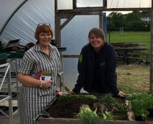 Bernie McKenna from Castlecaulfield Horticultural Society potting up a few herbs with Jenny McGetrick (TCV) at Castledawson Open Evening