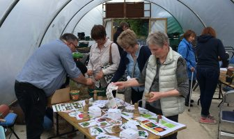 Visitors at Castledawson Open Evening taking part in the different activities ranging from sowing vegetables and wildflower seeds to potting up herbs and making bee homes to attract pollinators into the garden.