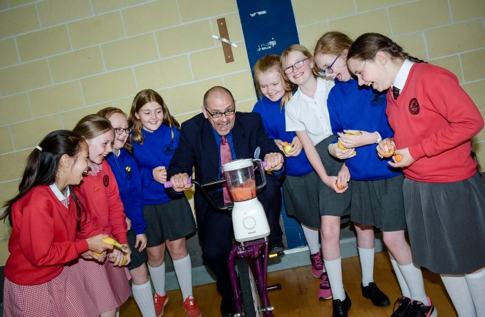: A group of energy detectives from Hazelbank and Longstone Primary Schools spotting how much energy it takes to make a smoothie with Tesco's Ronnie McFall