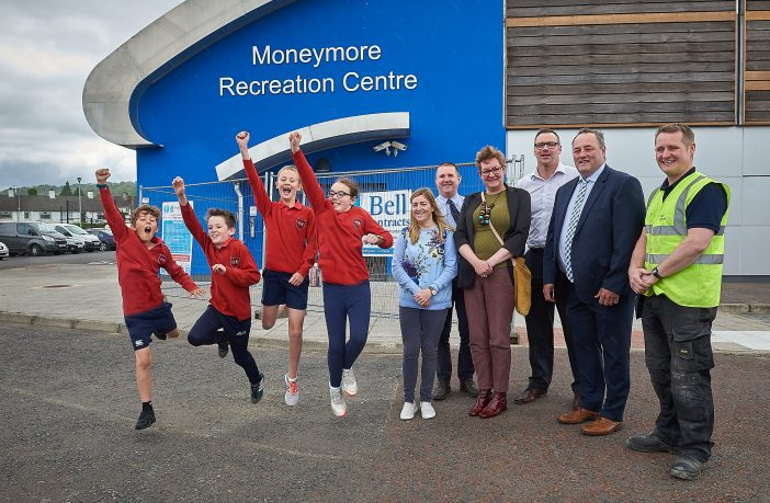 Year 6 pupils from Moneymore Primary School jump for joy at the refurbishment of Moneymore Recreation Centre as Bridie McFlynn, Moneymore GAC; Cormac McLaughlin and John Howard, Mid Ulster District Council; Susan Glass, Project Officer, CWSAN; Chair of Mid Ulster District Council's Development Committee, Cllr. Derek McKinney and Paul McSorley, Bell Contracts look on.