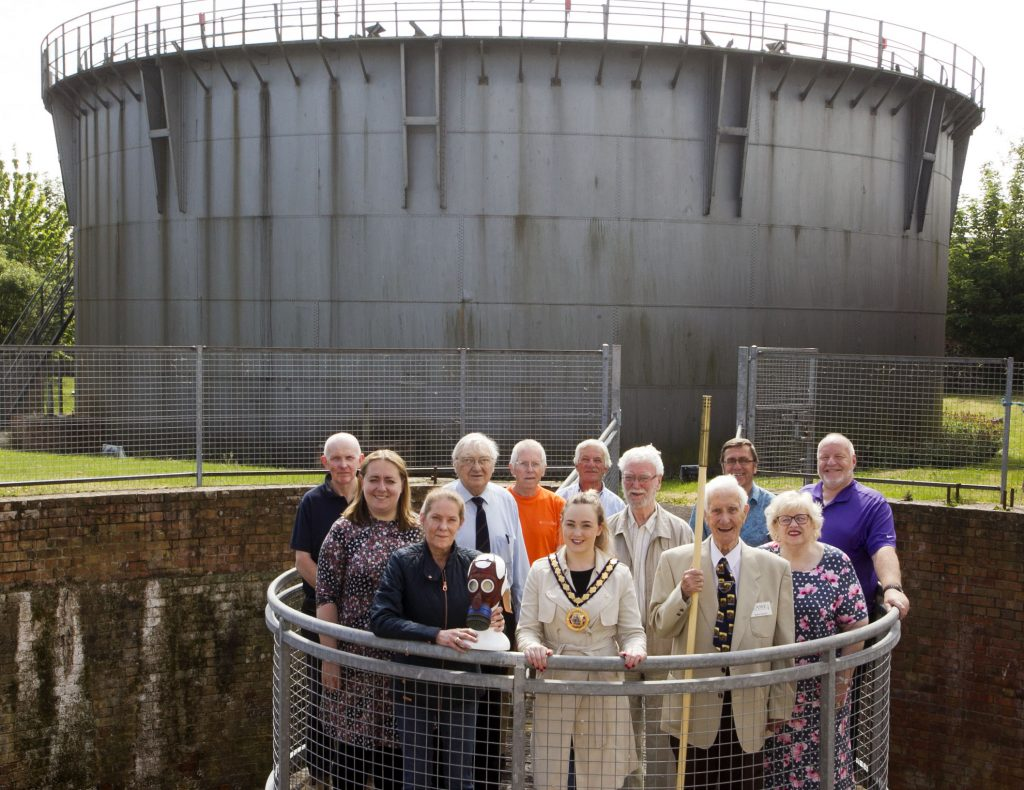 Mid & East Antrim Council Deputy Mayor, DUP Cllr Cheryl Johnston, pictured along with members from Flame Gasworks Museum in front of the only remaining Gas Holder in Ireland.