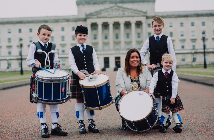 (L-R) Jamie Coffey (9), Evie McKeown (8), Oliver McIlwaine (9) and Thomas McIlwaine (3) join the new Lord Mayor of Belfast, Councillor Deirdre Hargey on her first official engagement to launch the UK Pipe Band Championships which will take place at Stormont Estate on Saturday, 16 June.