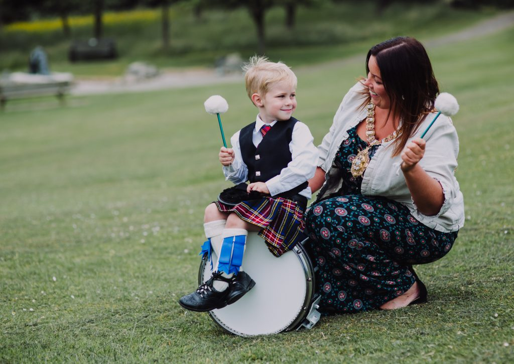 Thomas McIlwaine (3) helps the new Lord Mayor of Belfast, Councillor Deirdre Hargey on her first official engagement, launching the UK Pipe Band Championships which take place at Stormont Estate on Saturday, 16 June.
