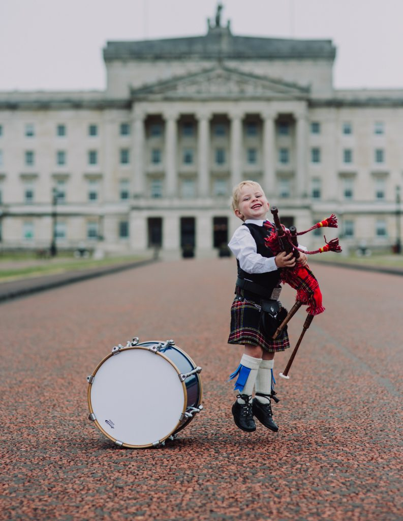 Thomas McIlwaine (3) jumps for joy at the launch of the UK Pipe Band Championships. He's looking forward to the free, family friendly event which will take place at Stormont Estate on Saturday, 16 June.