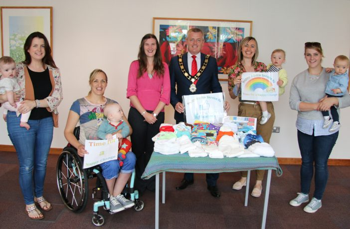 Mayor of Antrim and Newtownabbey, Councillor Paul Michael and Nicola Watson from the Nappy Advice Service NI promoting the cloth nappy packs. They are joined by local families who are currently trialling the cloth nappies; Samantha Logan & daughter Edith, Jean Daley-Lynn & son Harrison, Paula Hopwood & daughter Alana and Aimee Ellis & daughter Leila.