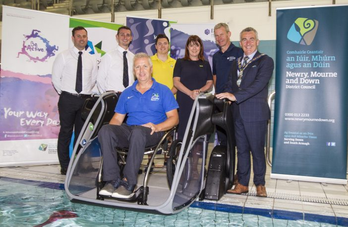 Friday the 6th July saw the Official unveiling of the newly installed 'Pool Pod' at NLC . The equipment will enable all abilities to access the swimming facilities at NLC. Left to Right ; Kieran Gordon, Head of Indoor Leisure, Niall Cuningham Duty Manager NLC,Aubrey Bingham, Disibility Sport NI, Matthew Topley Lifeguard , Anntoinette McKeown , Chief Executive Sport NI Tony Murphy , Sports Branch Department of Communities and Mark Murnin, Chairperson, Newry Mourne and Down District Council.