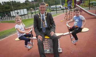 The Mayor of Derry City and Strabane District Council, Councillor John Boyle, pictured at the official opening of the new 'Invest in Play' Playpark in Kilfennan on Tuesday afternoon with local youngsters Elsie Alford (4) and Zak Parkhill (3).