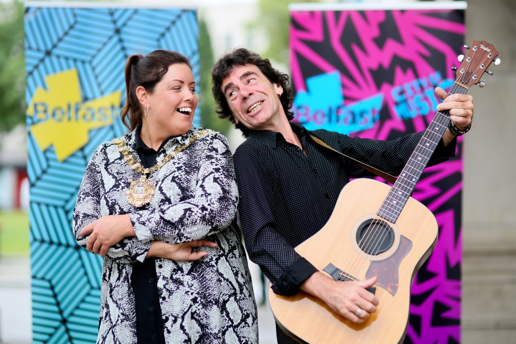 Lord Mayor of Belfast Councillor Deirdre Hargey with local singer/songwriter Davy Watson who is taking part in Belfast Music Summer Season which was launched at City Hall today. The pop-up summertime animation programme will shine a spotlight on Belfast's rich musical heritage and local music scene, bringing music to all corners of the city over the coming weeks.