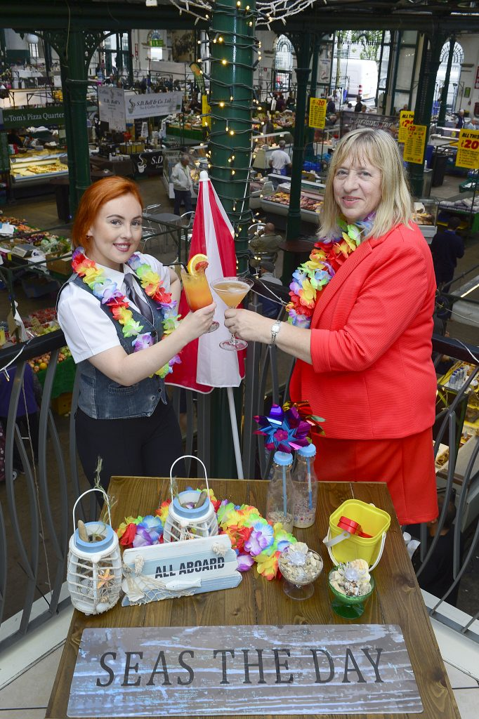 Courtney Smyth from Georges at the Market with Councillor Aileen Graham toast the success to success at the upcoming Twilight Market on 31 July-1 August at St George's Market.