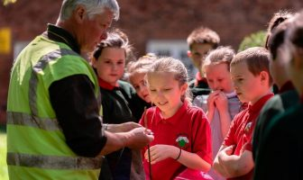 Brian Poots, General Manager of the Northern Ireland Forest School Association, shows pupils the basics of den building during a recent Forest School session.