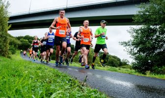 Athletes pass under the Foyle Bridge duirng the 2017 Waterside Half Marathon. Credit: Martin McKeown / Inpresspics.com