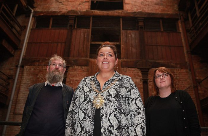 Lord Mayor, Councillor Deirdre Hargey with Nikki McVeigh, Chief Executive of Ulster Architectural Heritage Trust and Marcus Patton from Hearth Historic Buildings Trust in Riddel's Warehouse in Ann Street. The former iron warehouse will open to the public as a Heritage Hub on Saturday 8 and Sunday 9 September where a brand new exhibition on the legacy of red brick in the city will be on display in the atrium of the building.