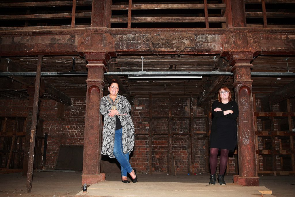 Lord Mayor Councillor Deirdre Hargey is joined by Nikki McVeigh, Chief Executive of Ulster Architectural Heritage Trust in Riddel's Warehouse in Ann Street. The former iron warehouse will open as a Heritage Hub on Saturday 8 and Sunday 9 September where a brand new exhibition on the legacy of red brick in the city will be on display in the atrium of the building.