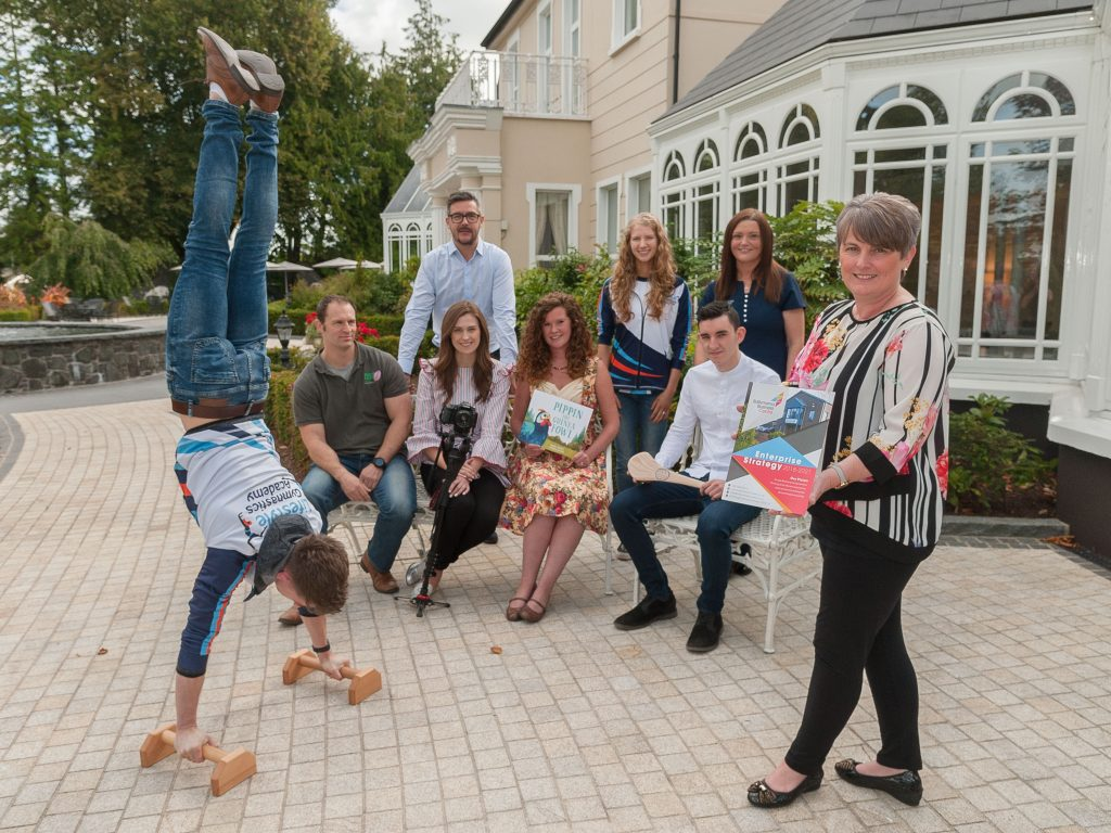 Pictured are some of the local entrepreneurs at the Ballymena Business Centre's Enterprise Strategy's launch with Melanie Christie Boyle, Chief Executive of the Ballymena Business Centre, John Mills showing his gymnastic skills from Lifestyle Gymnastics Academy with (left to right) Mark McIntyre of New Leaf Hub, Kathryn Hamilton of Day and Age Films, Jennifer Davison of Jens Sketches, Emmet Martin of Martin Hurls. Back row, Gary Tinsdale of Tinsdale Furniture, Kathryn Mills of Lifestyle Gymnastics Academy and Lynne McCartney, a receptionist from Galgorm Dental.