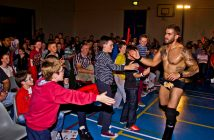 Dunkan Disorderly greets fans at ringside.