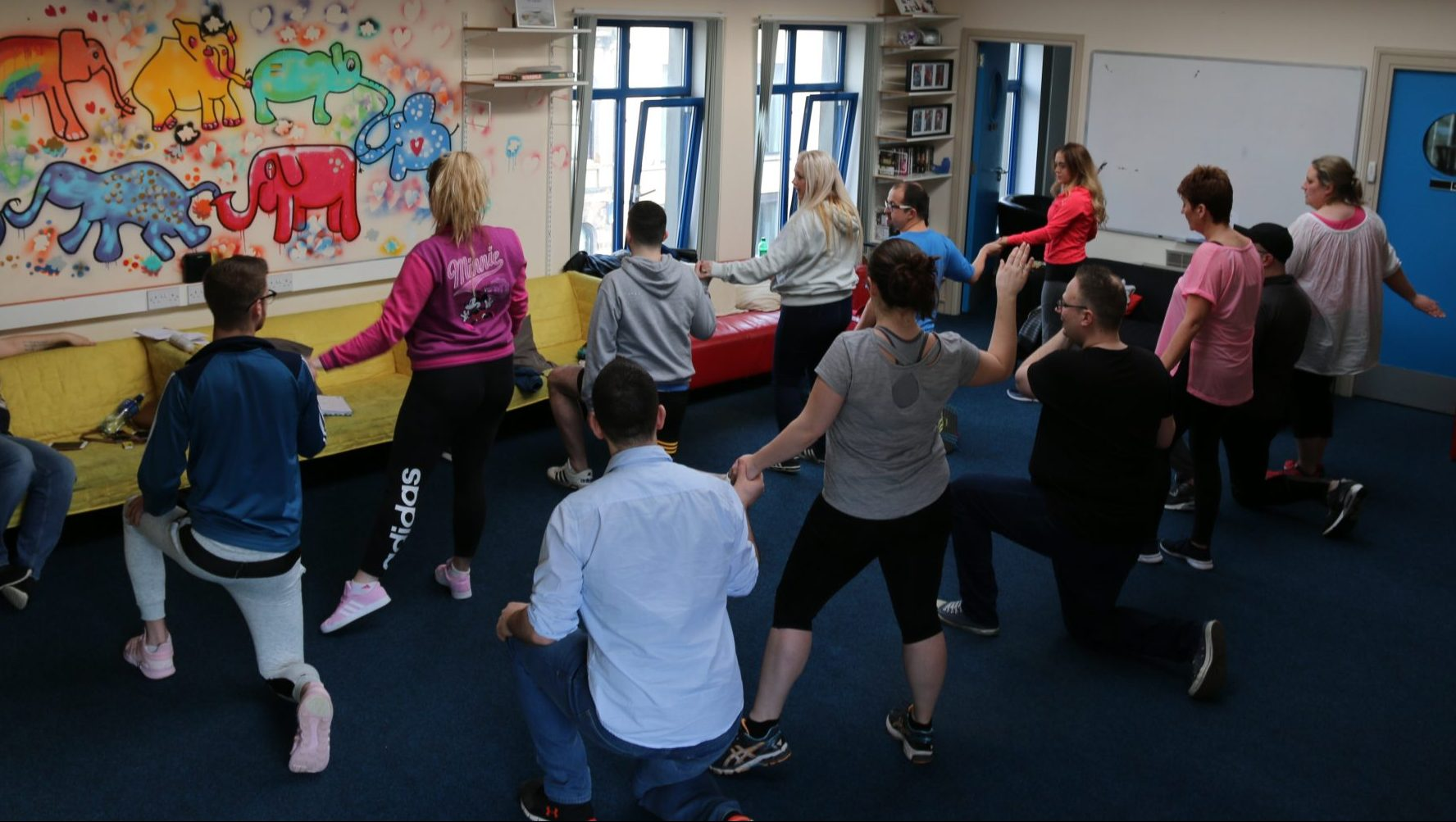 Volunteers rehearsing their steps ahead of the big show to raise funds for The Rainbow Project.
