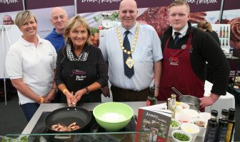 Mayor Paul Reid at Mid and East Antrim Borough Council's stand alongside chef Jenny Bristow and some of the borough's artisan producers