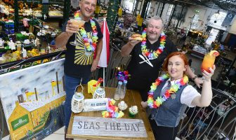 St George's market traders toast the forthcoming Twilight Market taking place on Tuesday 31 July- Wednesday 1 August with a 'Beach party' theme. (l-r) Artist Foss, Sean McCann and Courtney Smyth.