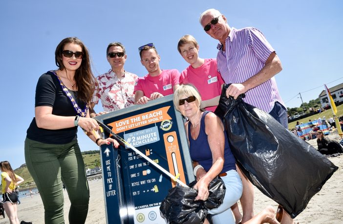Mayor of Mid and East Antrim Cllr Lindsay Millar with volunteers at Ballygally Beach