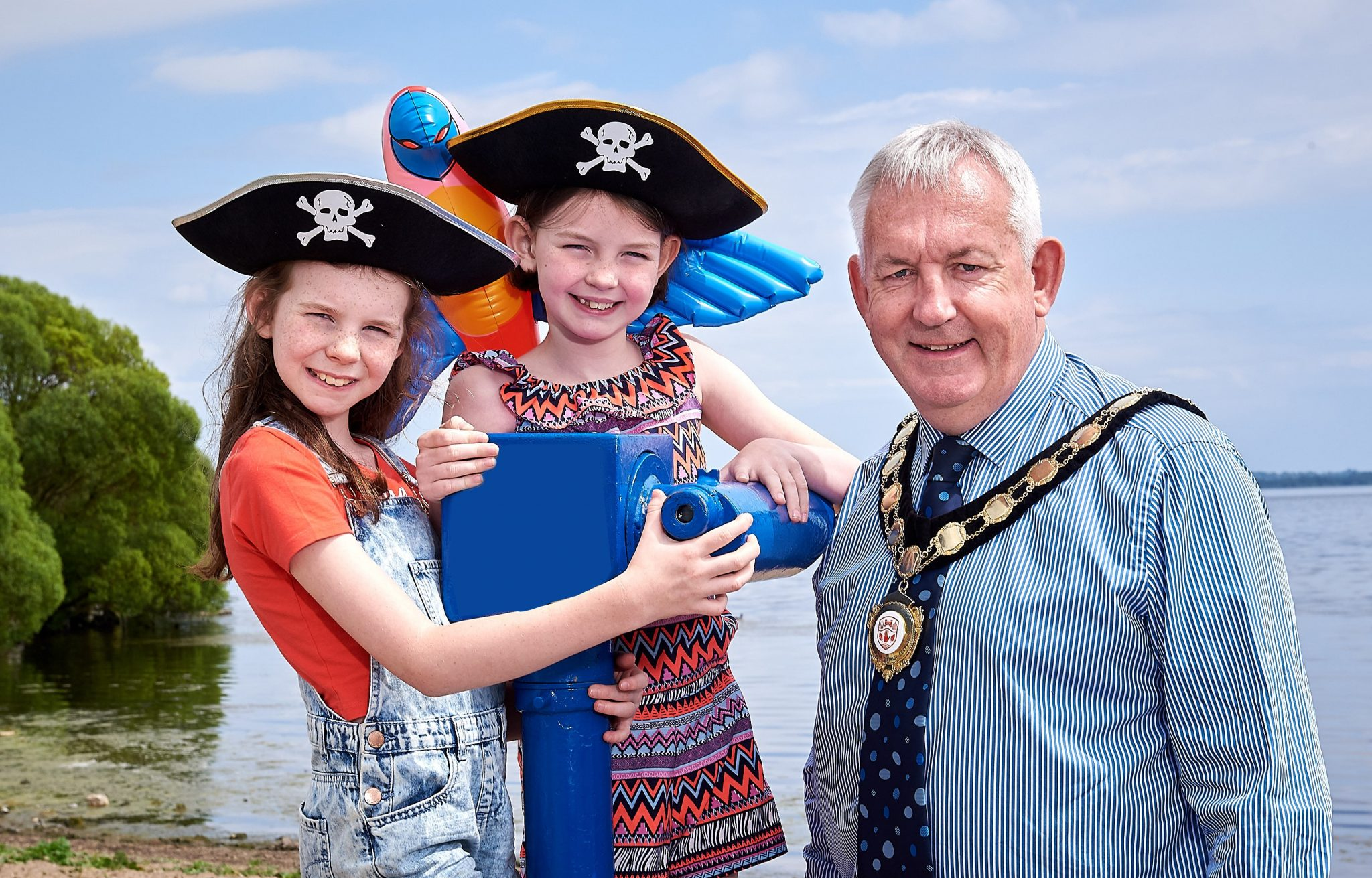 Chair of Mid Ulster District Council, Councillor Sean McPeake is pictured with some excited pirates ahead of this year's Lumarina which takes place at Ballyronan Marina on Friday 17th and Saturday 18th August